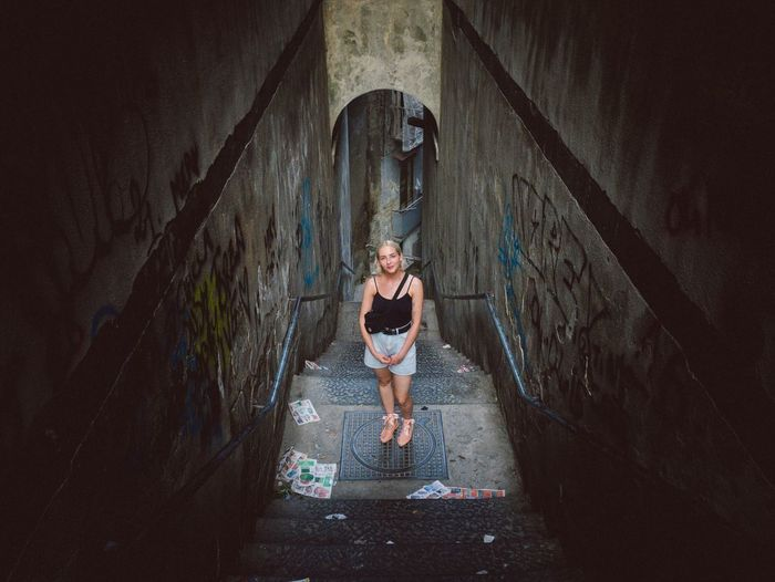 Portrait of woman standing in abandoned building