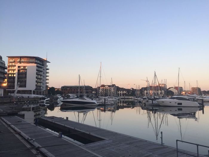 Marina view EyeEm Selects Water Sky Transportation Nautical Vessel Mode Of Transportation Architecture Building Exterior Harbor No People Built Structure City Sunset Outdoors Sailboat Building Reflection Nature Clear Sky Moored