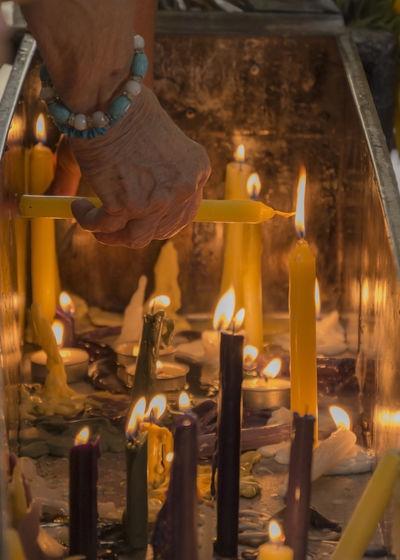 perpetuum Catholicism Sanctuary  Havana Cuba Sanlazaro Hand Human Hand Religion City Place Of Worship Spirituality Candle Close-up Burning Flame Campfire Candlelight Wax Lit Altar Fire