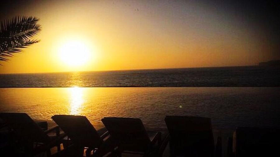 Beach Beauty In Nature Sunset Sea Sea And Sky Beautiful Nature Scenics Ocean Ocean View Pool Poolside Sun Tranquil Scene No People Chair Vacations Horizon Over Water Outdoors Clear Sky Peace And Quiet Beautiful Sunset Wonderful Sunset 🌇 Dakar Radissonblu Radissonbluhotel