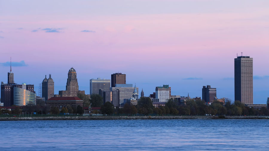 Buffalo skyline as night falls Built Structure Building Exterior Architecture City Water Building Waterfront Office Building Exterior Skyscraper Sky Sunset Urban Skyline Cityscape Modern Landscape Nature Tall - High Office River Outdoors High Financial District  Cityscape