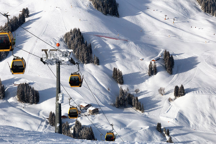 High angle view of overhead cable car on snowcapped mountains