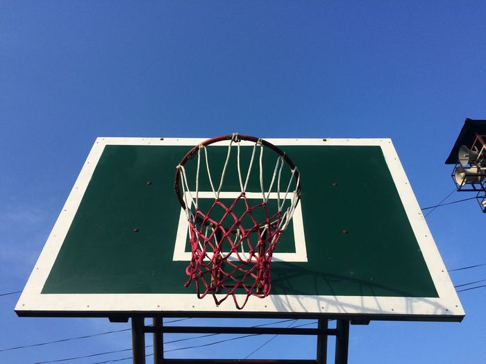 Sky Basketball - Sport Blue Clear Sky Sport Basketball Hoop Nature Low Angle View Copy Space No People Day Net - Sports Equipment Outdoors Sports Equipment Metal Relaxation Shape Green Color Sunlight Team Sport