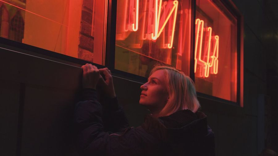 Blond Hair Red Color Red Pizza Neon One Person Night Illuminated Young Adult Portrait Headshot Leisure Activity Window Adult Lifestyles Looking Architecture Real People Young Women Women Warm Clothing Nightlife