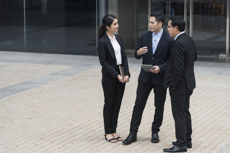 Group of business asian partner discussing while walking in office building. colleague social concept. Young Work Woman Walking Training Think Teamwork Team Talking Tablet Speaking Sharing  Professional Plan People Partnership Partner Office Meeting Manager Management Man Explaining  Executive  Employee Discussion Discussing Coworkers Corporate Conversation Consulting Confident  Communication Colleagues Colleague Businesswoman Businesspeople Businessman Business Boss Attractive Happy Success Worker Group Outdoor Successful Asian  ASIA