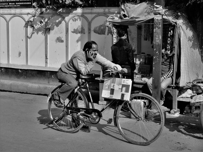 Man cycling bicycle in city