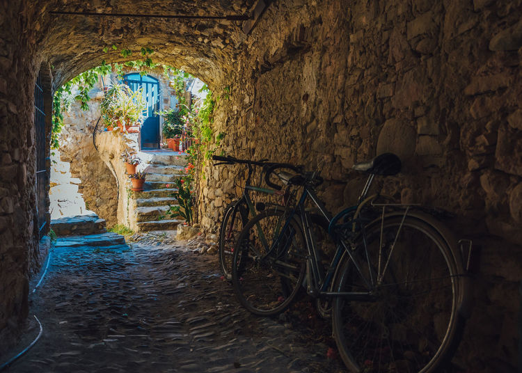 Alley Arch Architecture Bicycle Building Building Exterior Built Structure Day Direction Land Vehicle Mode Of Transportation Narrow Nature No People Old Outdoors Stone Wall The Way Forward Transportation Wall Wall - Building Feature