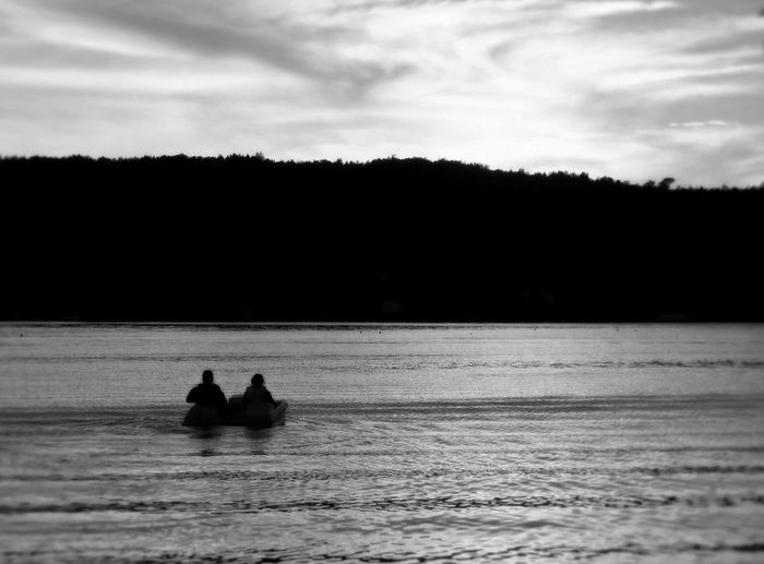 Profile of a couple in a pedal boat on the lake at sunset Water Sky Real People Two People Men Waterfront Nautical Vessel Silhouette Sea Leisure Activity Cloud - Sky Mode Of Transportation Togetherness Nature Transportation People Beauty In Nature Horizon Day Horizon Over Water Outdoors Couple - Relationship Black And White Blackandwhite Black And White Photography