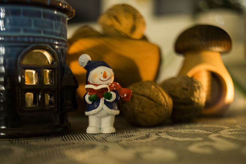 christmas time Representation Human Representation Toy Art And Craft Figurine  Still Life Indoors  No People Female Likeness Stuffed Toy Creativity Doll Selective Focus Table Male Likeness Craft Close-up Sculpture Christmas Decoration Christmas Candle Candlelight