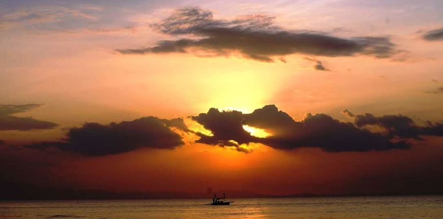A day in the life of a Fisherman. Philippines Pangasinan Fisherfolk Boatinglife Travel Sunset Orange Clouds