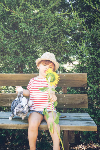 Sunflower Summer Girl Childhood Plant Leisure Activity Sitting Seat Real People Child Lifestyles Day One Person Hat Nature Casual Clothing Women Portrait Tree Front View Girls Outdoors Toddler  Park Hat