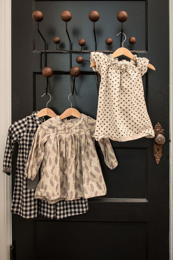 Clothes hanging on door at home