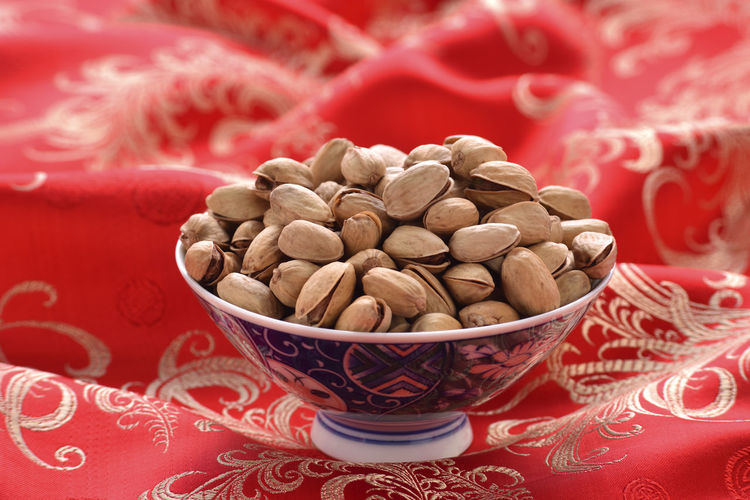 Nut snacks New Year Seed Bite Bowl Chinese New Year Close-up Day Dried Fruit Food Food And Drink Freshness Granules Health Healthy Eating Indoors  Large Group Of Objects No People Nut Nutrition Pistachio Red Snacks