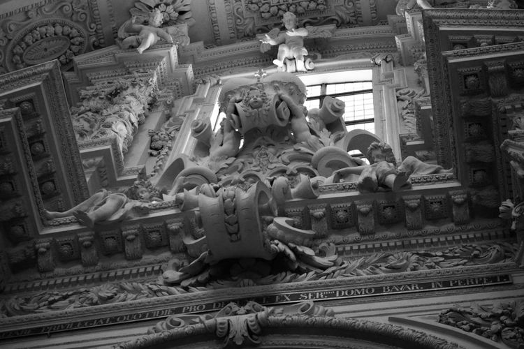 Architecture Art And Craft Baroque Baroque Style Building Exterior Built Structure Cathedral Chinese Dragon Church Creativity Day Dragon Human Representation Low Angle View Male Likeness No People Outdoors Place Of Worship Relief Sculpture Relief Work Religion Sculpture Spirituality Statue