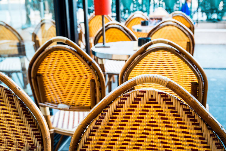 Close-Up Of Empty Chairs And Table At Cafe