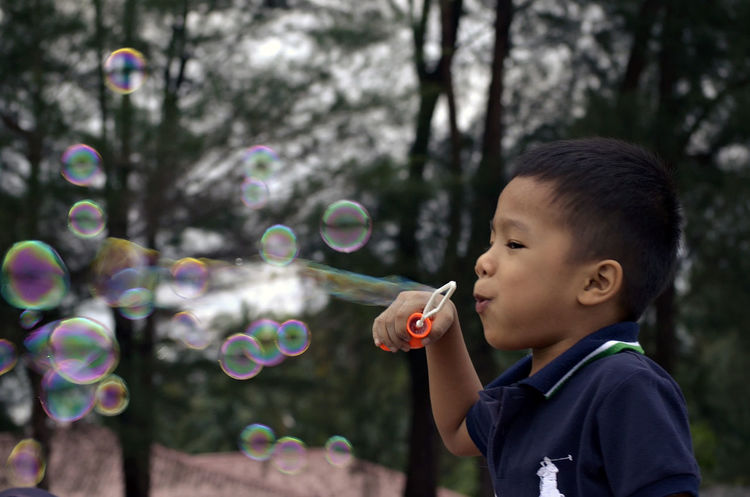 amazing boy happily playing water bubbles Balloon Birthday Boy Favourite Happy Time Hobby Kiddy Play Rousing Water Bubbles Wind