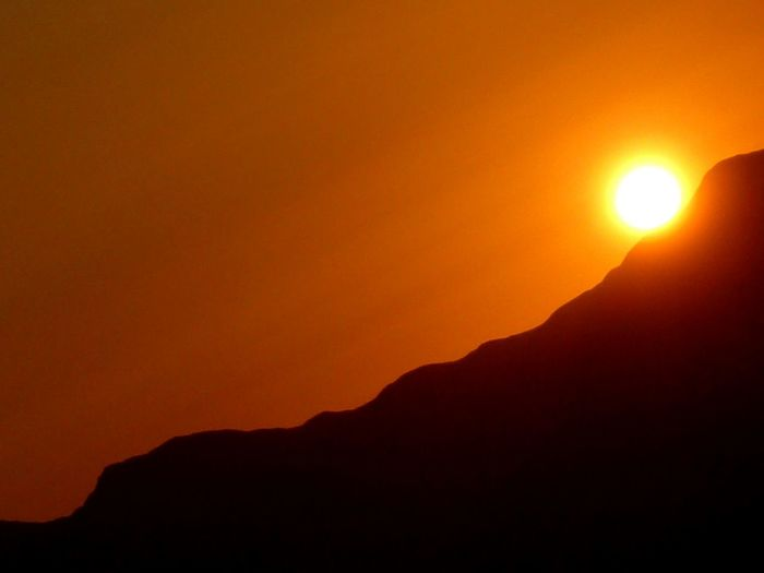 Yellow Orange Color Shadow Peru Travel Ball Sunset Silhouette Dramatic Sky Landscape Nature Mountain Scenics Beauty In Nature No People Sun Tranquility Outdoors Travel Destinations Sky Day Tranquil Scene