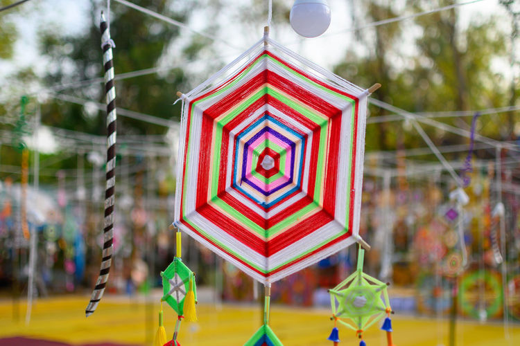 Close-up of multi colored toy hanging in playground