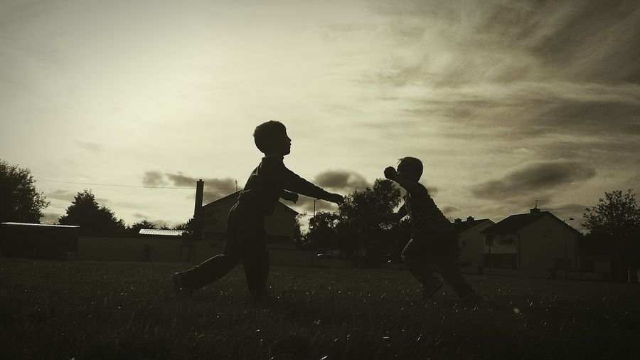 Trying different edit Playing Togetherness Full Length Childhood Leisure Activity Side View Lifestyles Motion Playful Friendship Carefree Fun Boys Outdoors Field Editing Photos Taking Photos Freelance Life Atmospheric Mood Retrostyle EyeEm Best Shots Monochrome Photography