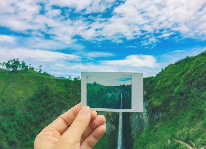Feel The Nature Wild Nature Hand Waterfall Concept Travel Adventure EyeEm Selects Human Hand Tree Photograph Photography Themes Holding Picture Frame Human Finger Sky Close-up Cloud - Sky Frame Personal Perspective Camera Film Instant Camera
