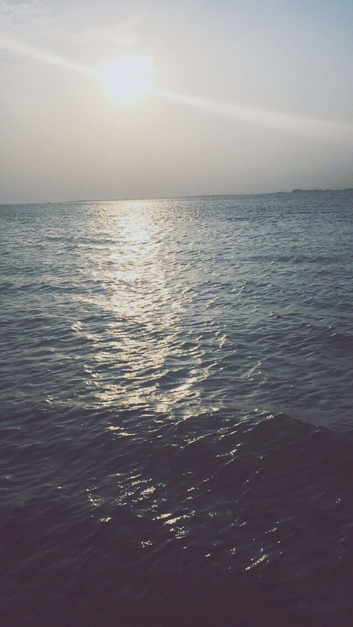 sea, beauty in nature, nature, sunset, tranquil scene, water, tranquility, horizon over water, sky, scenics, sunlight, outdoors, summer, no people, beach, day, refraction