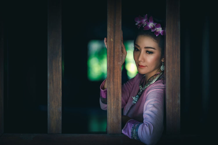 Beautiful Thai woman with traditional Lanna cloth. One Person Young Adult Portrait Women Leisure Activity Real People Looking At Camera Looking Young Women Lifestyles Indoors  Front View Sitting Beauty Beautiful Woman Contemplation Waist Up Purple Hairstyle Innocence Thailand Lanna Culture Traditional Clothing Thai Travel Dress Old-fashioned Antique