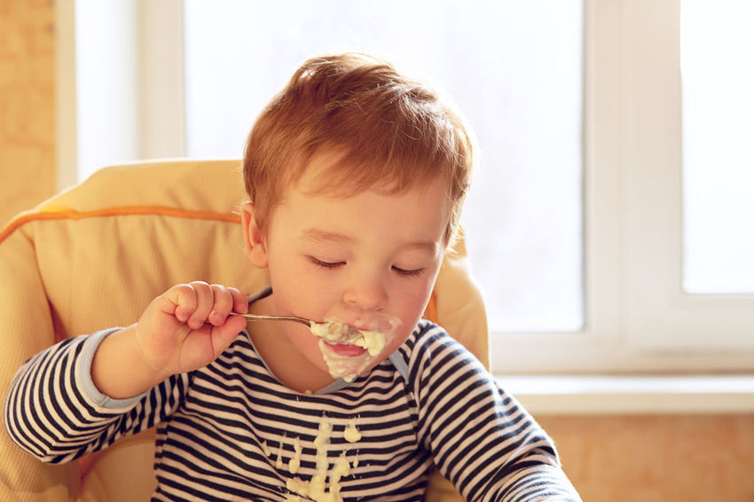 Adorable Appetite Baby Chair Boy Breakfast Caucasian Child Childhood Eat Eating Emotion Food Happy Health Kid Morning Porridge Positive Sunlight Young