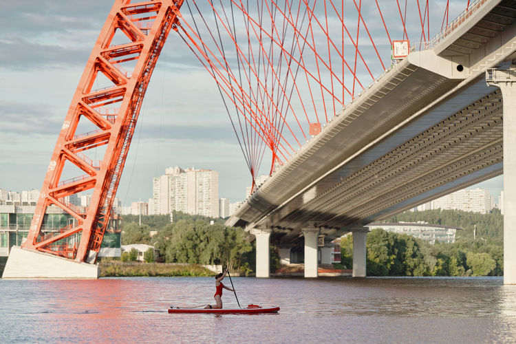 People on bridge over river