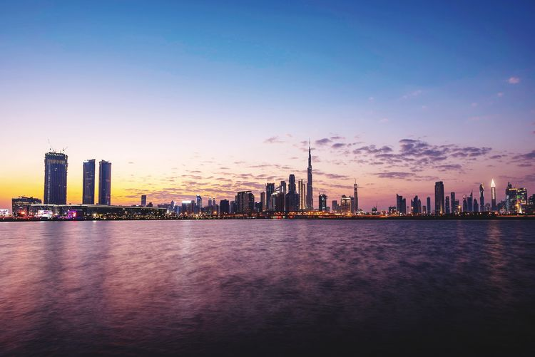 Sunset on DUBAI 🇦🇪 Building Exterior City Sky Skyscraper Built Structure Office Building Exterior Urban Skyline Architecture Cityscape Landscape Building Water Waterfront Sunset Modern Illuminated Tall - High No People Outdoors