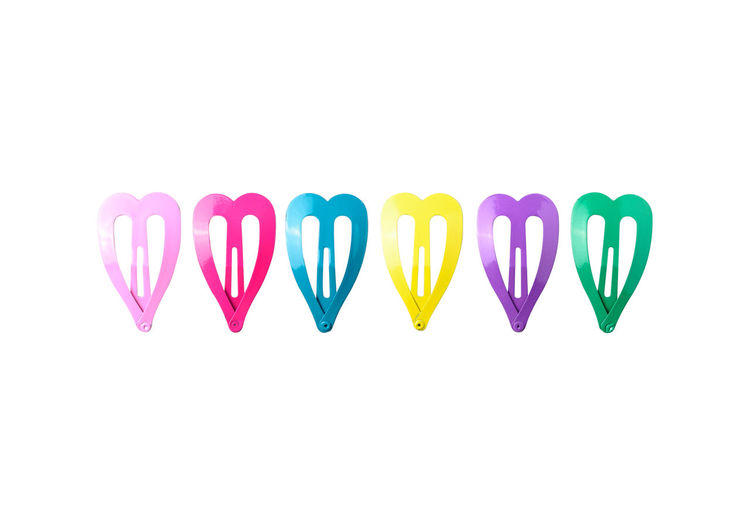 Colored hair clips isolated on white background. Pink Color Fashion Pastel Colors Beautiful Heart Shape Hairclip Festival Hairstyle Young Kids Females Decoration Accessories Cute Close-up Clip Metel Girl Women Isolated White Background Brooch