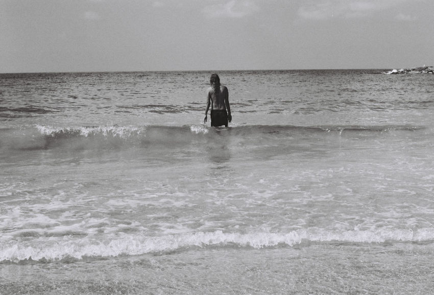 a day at the beach Film Photography Filmisnotdead Black And White Blackandwhite Sea Water Sky Land Horizon Beauty In Nature Horizon Over Water Motion Scenics - Nature Nature Outdoors One Person Real People Leisure Activity Waterfront Lifestyles Vacations Trip Holiday