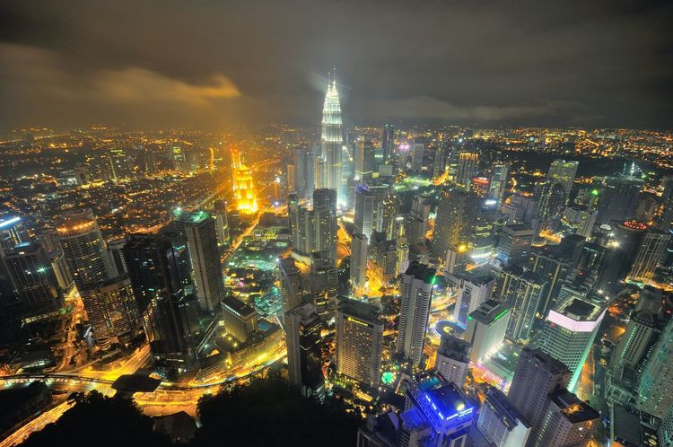 Kuala Lumpur skyline at night Cloud Cloudy Day Night Lights Aerial View Architecture Background Building Exterior Built Structure Business Finance And Industry City Cityscape High Angel View High Angle View Illuminated Landmark Modern Night No People Outdoors Sky Skyscraper Travel Destinations Urban Skyline Paint The Town Yellow Mobility In Mega Cities