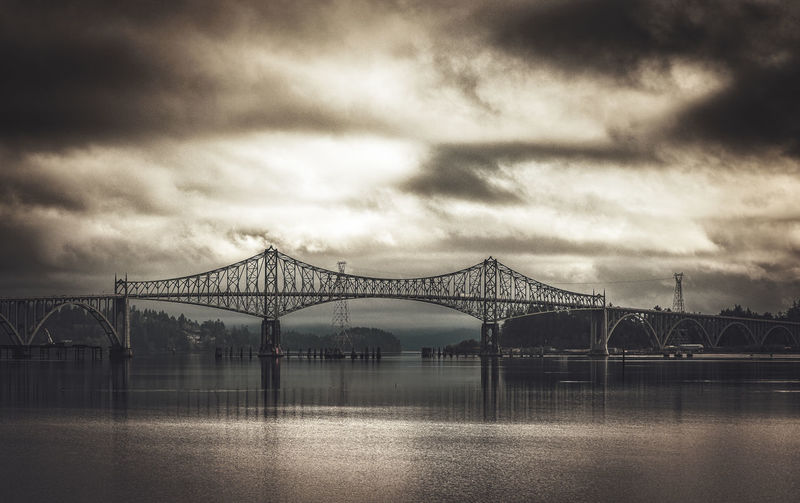 Moody sky over the McCullough Bridge in Coos Bay, Oregon Architecture Architecture_collection Oregon Oregon Beauty Architecture Bridge Bridge - Man Made Structure Built Structure Cloud - Sky Connection Coos Bay Engineering Mccullough Nature Oregon Coast Outdoors Overcast Reflection River Sepia Sky Transportation Travel Destinations Water Waterfront
