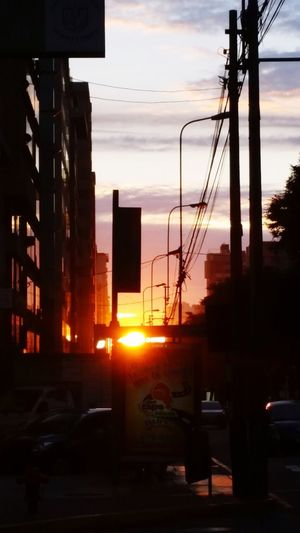 Car Sunset Transportation City Architecture Sky Land Vehicle Built Structure Silhouette No People Mode Of Transport Road Building Exterior Outdoors Illuminated Cable Electricity Pylon Skyscraper Day EyeEmNewHere