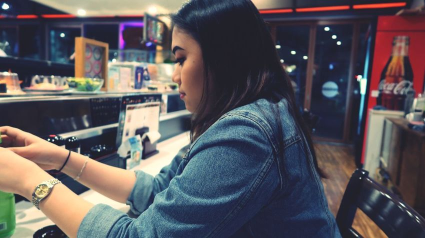 The Week On EyeEm Real People Casual Clothing One Person Focus On Foreground Indoors  Side View Night Sitting Technology Young Adult Young Women Close-up Sushi Canong7xmarkii Canonphotography Side Profile EyeEmNewHere