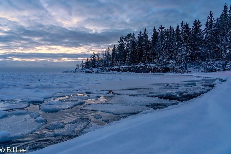 Just a hint of sunrise Streamzoofamily Wildlife & Nature Two Harbors Winter Sunrise Malephotographerofthemonth Minnesota Lake Superior Winter Sky Cloud - Sky Cold Temperature Beauty In Nature Snow Scenics - Nature Water Nature No People Tranquil Scene Frozen Outdoors