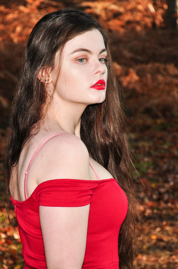 Beautiful young lady in a red dress in the forest Girl Millenial Young Lady Red Dress Red Red Color Red Lipstick Forest Trees Beauty Beautiful Woman Beautiful Long Hair Portrait Portrait Of A Woman Portrait Photography Stunner Beautiful Young Lady Beautiful Young Woman Autumn Autumn colors autumn mood Young Adult Young Women One Person Hair Lipstick Fashion