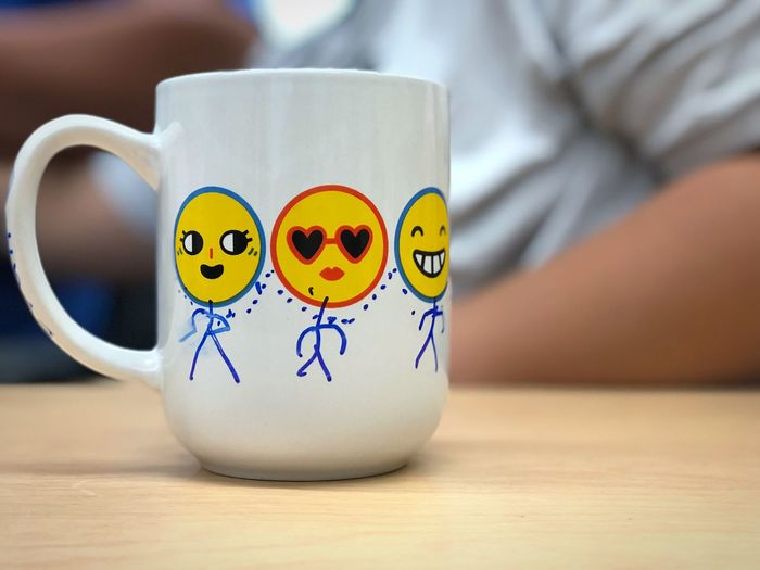Funny face stick people on a mug EyeEm Selects Table Representation Close-up Food And Drink Art And Craft Indoors  Creativity Still Life Anthropomorphic Smiley Face Smiling Human Representation Focus On Foreground Anthropomorphic Cup Food Mug Anthropomorphic Face