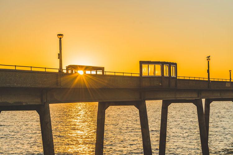 Silhouette of bridge at sunset