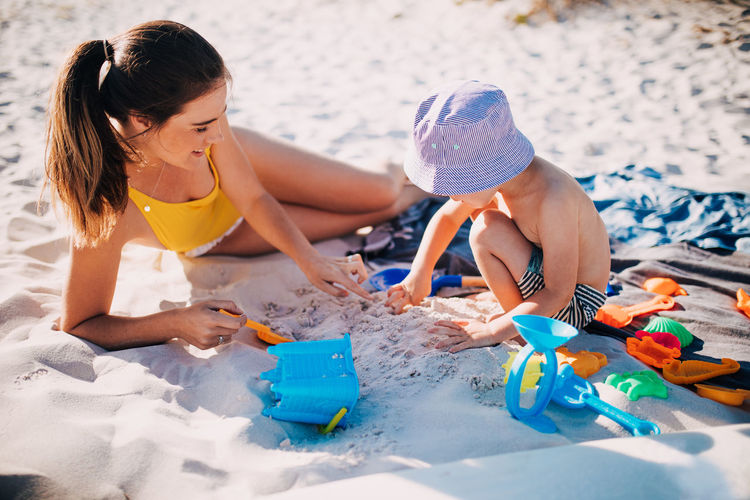Child Real People Leisure Activity Childhood Lifestyles Girls Toy Women Beach Females People Land Playing Sitting Nature Day Water High Angle View Boys Innocence