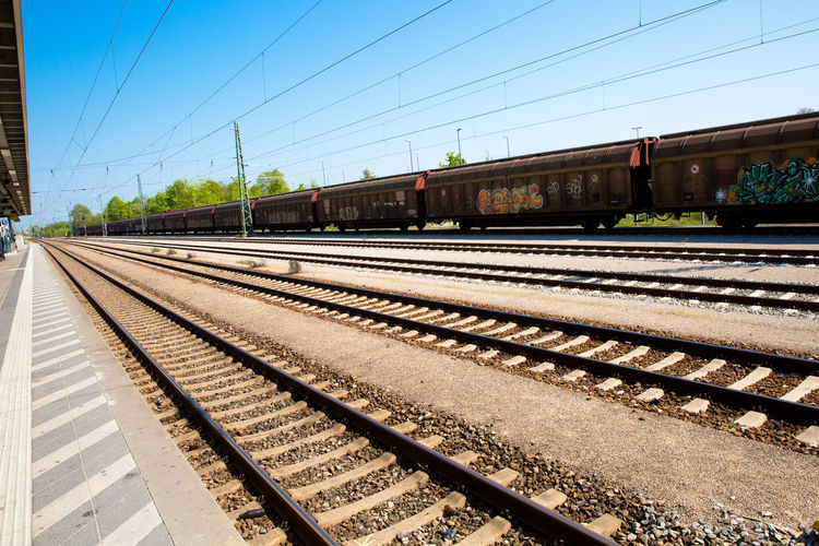 Rail Transportation Track Railroad Track Sky Transportation Nature Mode Of Transportation Day Clear Sky Sunlight Train No People Public Transportation Train - Vehicle Cable Electricity  Architecture Freight Train Travel Built Structure Outdoors Power Supply Shunting Yard Grafitti Platform