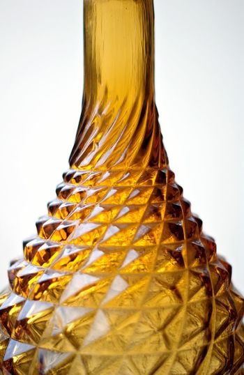 Food And Drink Gold Colored Studio Shot No People Yellow Indoors  Close-up Day Bottle Glass Bottle Pattern Textured Glass Decorative Indoors  Texture Glassware Warm Colors Golden Glass Macro Ornament Close Up Symetry Glass Textured