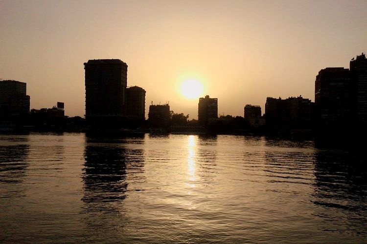the river nile ❤ Skyscraper Sunset Urban Skyline Architecture Cityscape City Reflection Building Exterior Modern Sky Water Outdoors River City Life Downtown District No People Built Structure