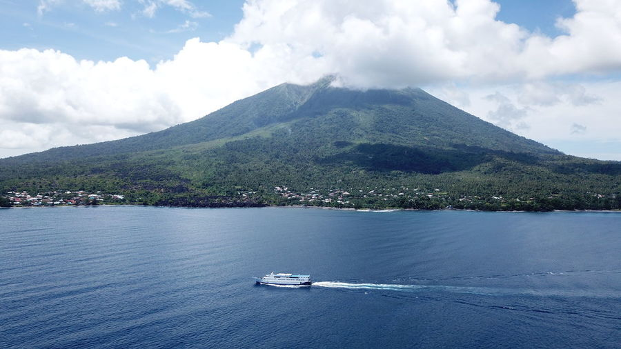 Ternate City with Mount Gamalama as its background, North Maluku (Mollucas) Aerial Shot City DJI Mavic Pro DJI X Eyeem Drone  Aerial View Architecture Beach Beauty In Nature Cloud - Sky Day Dji Maluku  Maluku Utara Mavic Pro Mode Of Transport Mountain Mountain Range Nature Nautical Vessel No People Outdoors Scenics Sea Sky Tranquil Scene Tranquility Transportation Travel Destinations Tree Water Waterfront