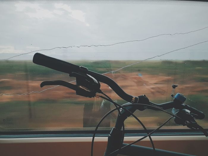 Bicycle seen through glass window