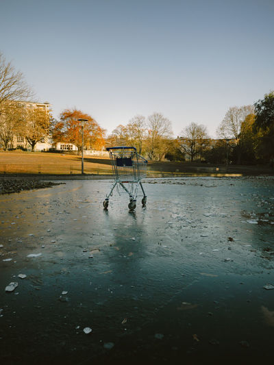 Shopping cart on a frozen pond - actually a pretty nice visual metaphor for dangers in online shopping Cold Customer  Dangerous Dangers Day Ecommerce Fraud Frozen Insecure Nature No People Online Shopping  Outdoors Pond RISK Security Shopping Cart Sky Theft Water