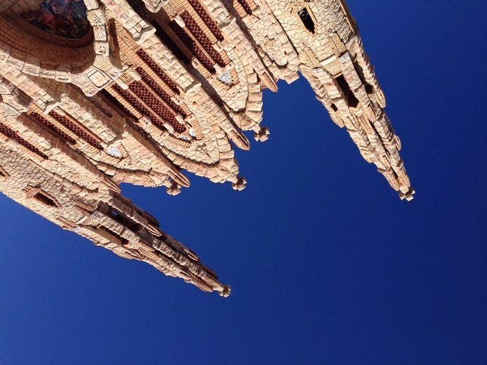Directly below view of santuario de santa maria magdalena against clear sky