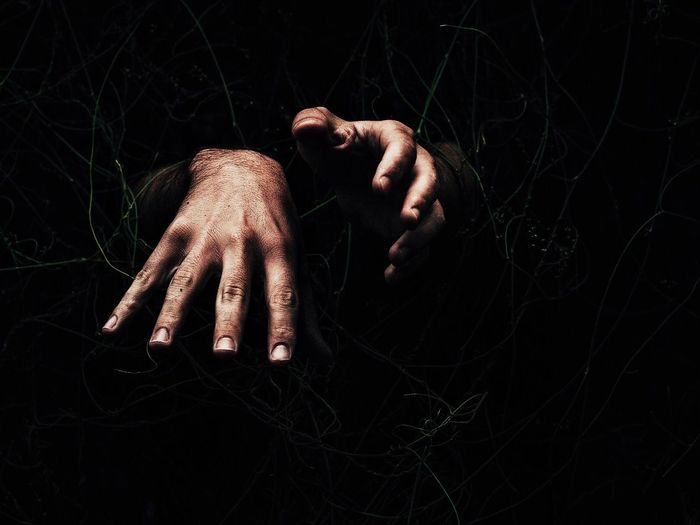 Close-up of hands over black background