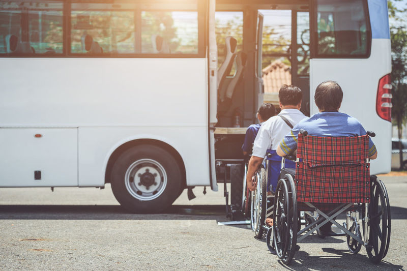 Rear view of people sitting in bus