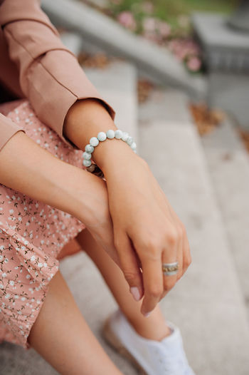 Woman beauty hand and white jewel